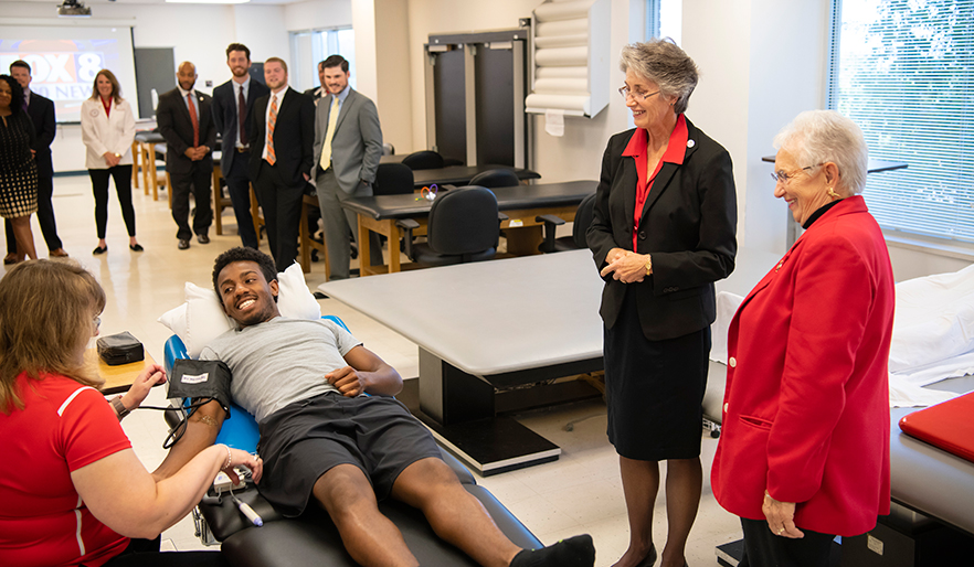 Congresswoman Foxx watches a physical therapy patient demonstration