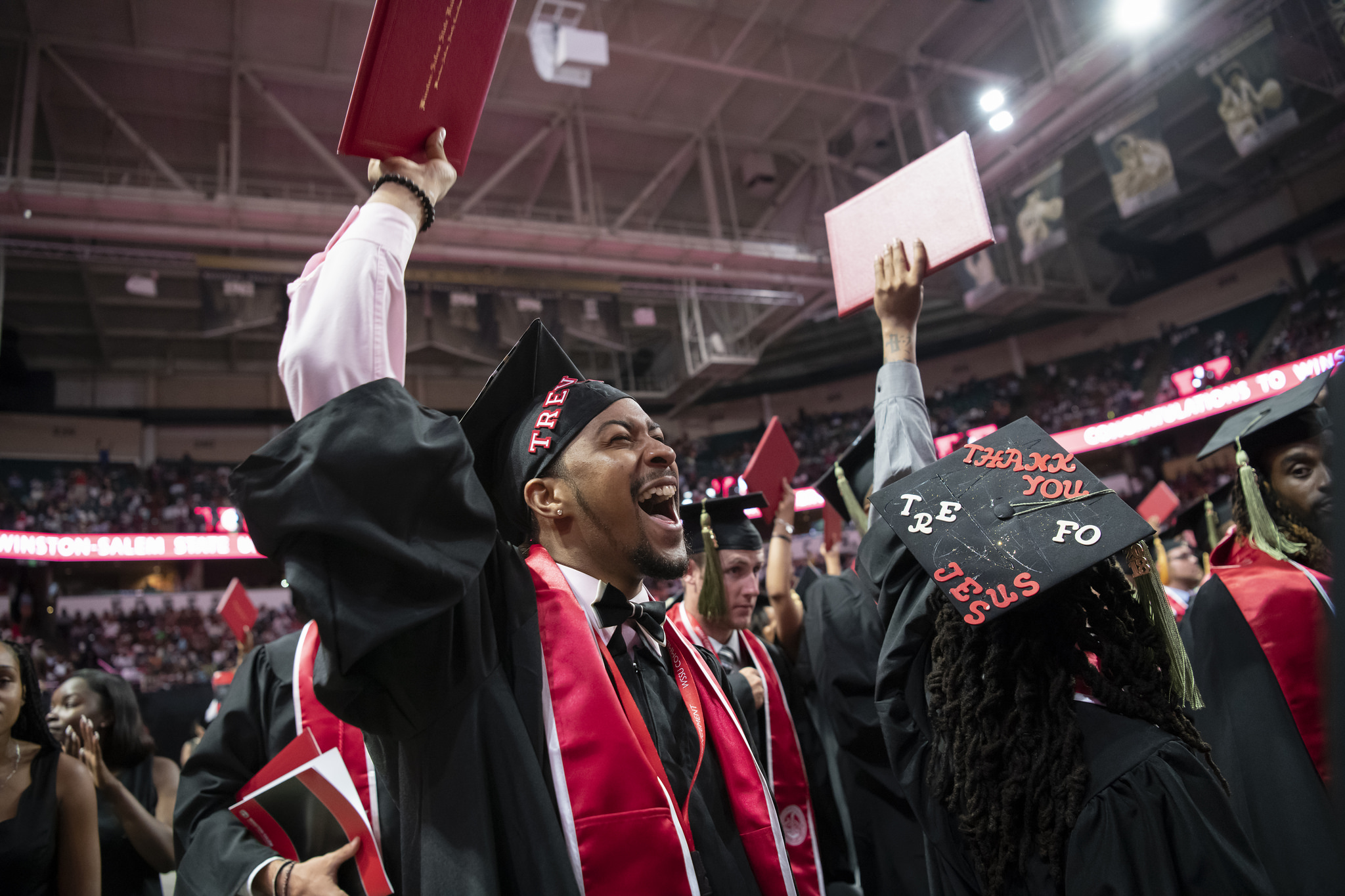 graduate celebrates at May's commencement ceremony