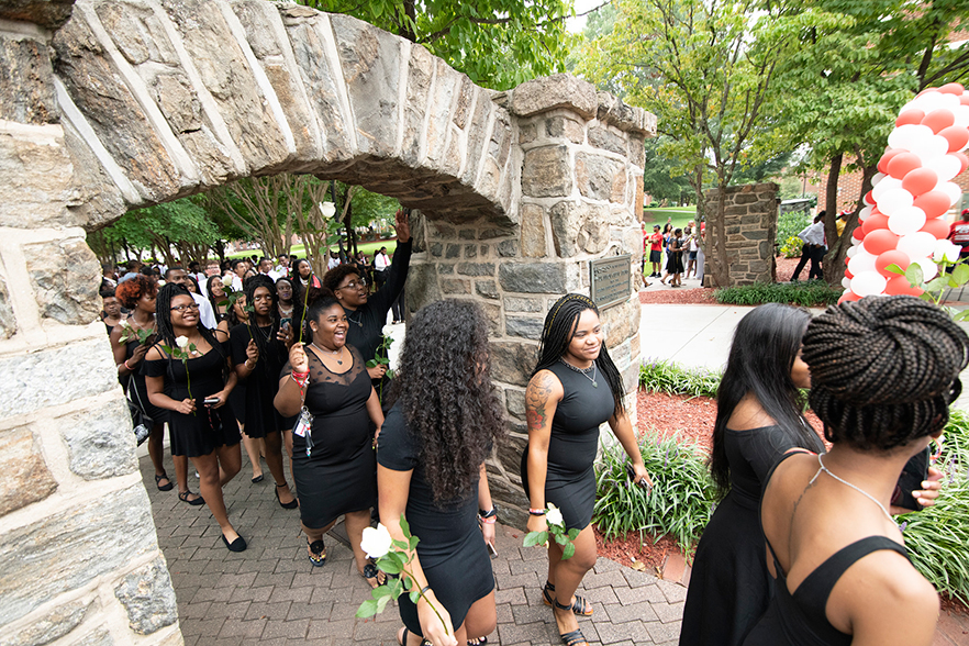 Students walk through the historic archways during Ramdition