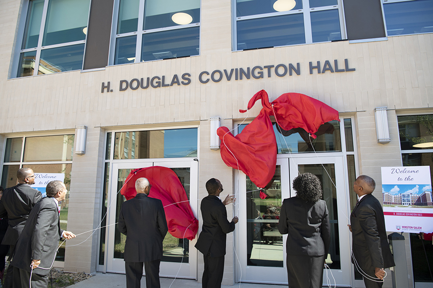 H. Douglas Covington Hall sign is unveiled on side of building