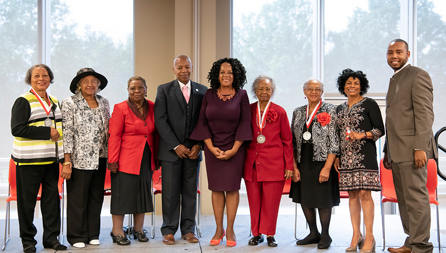 Group photo of honorees and speaker at the Healthcare Legends of East Winston event