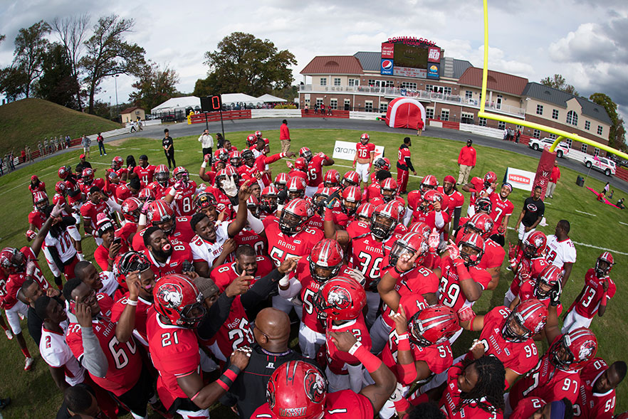 WSSU football team before the start of game - fieldhouse is in the background