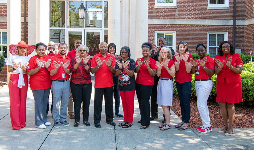 staff wearing red outside Blair Hall