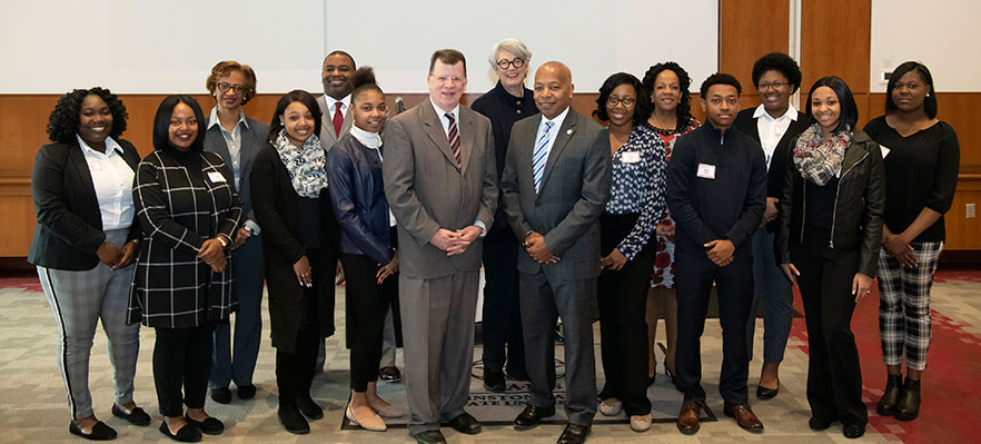 WSSU students and administrators stand with Golden Leaf Foundation president
